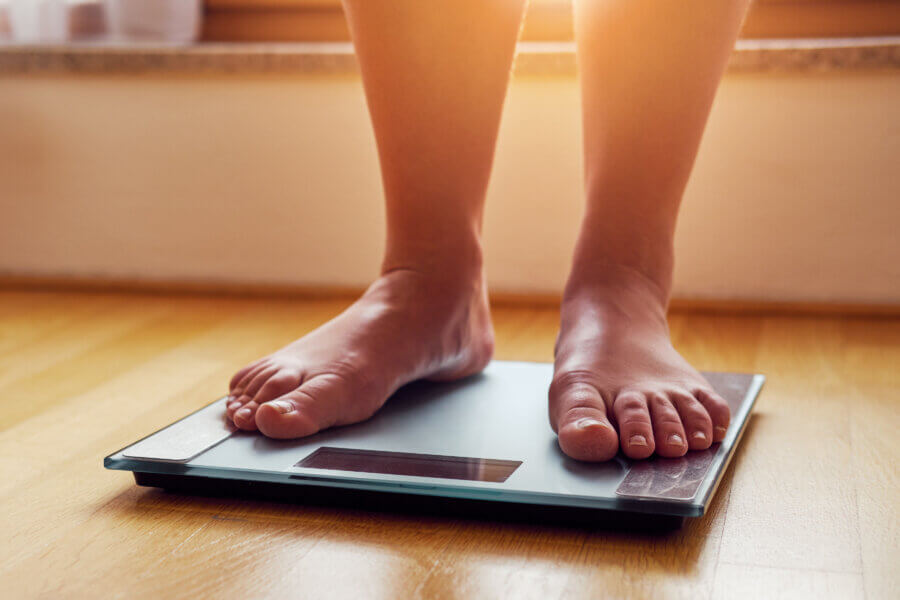 weight  Female bare feet on weight scale